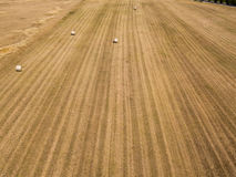 Nature and landscape: Aerial view of a field, haystacks, hay bales Royalty Free Stock Images
