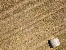 Nature and landscape: Aerial view of a field, haystacks, hay bales Royalty Free Stock Photo