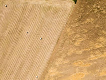 Nature and landscape: Aerial view of a field, haystacks, hay bales Stock Images