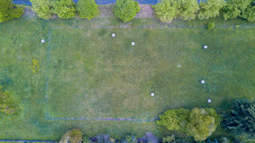 Nature and landscape: Aerial view of a field, plowed field, cultivation, green grass, haystacks, hay bales Royalty Free Stock Photos