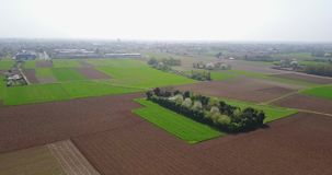 Nature and landscape: Aerial view of fields, trees and plowed fields, cultivation, green grass, dirt road stock video footage