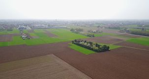 Nature and landscape: Aerial view of fields, trees and plowed fields, cultivation, green grass, dirt road stock video