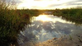 Nature landscape lake reflection of clouds in the water sunset sunlight royalty free stock photography