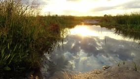 Nature landscape lake reflection of clouds in the water sunset sunlight stock video footage