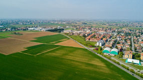 Nature and landscape, municipality of Solaro, Milano: Aerial view of a field, houses and homes, Italy Royalty Free Stock Image