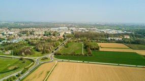 Nature and landscape, municipality of Solaro, Milano: Aerial view of a field, houses and homes, Italy Stock Image