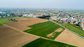 Nature and landscape, municipality of Solaro, Milano: Aerial view of a field, houses and homes, Italy Stock Photography