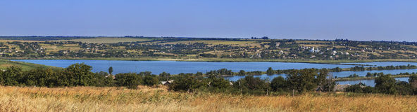 Nature, landscape, panorama. Panorama includes a view of the village and the river Royalty Free Stock Photos