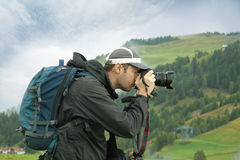 Nature and landscape photographer in Dolomite. Hobby nature photographer in action Stock Photo
