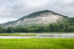 Nature landscape. Stone mountain and green forest near river Royalty Free Stock Images