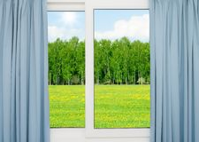 Nature landscape with a view through a window with curtains Royalty Free Stock Photo