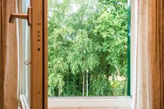 Nature landscape with a view through a window with green trees stock photography