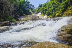 Nature landscape of waterfall cascade during bright day. royalty free stock photos
