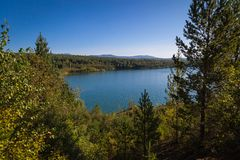 Nature landscape. Wide view of landscape with blue lake and wild forest stock photo