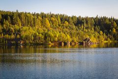 Nature landscape. Wide view of landscape with blue lake and wild forest stock photography