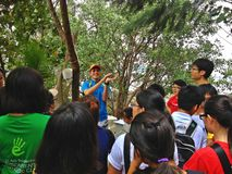 Nature lesson. A member of the Nature Society (Singapore) briefing the group about horseshoe crabs in Mandai mudflats royalty free stock photo