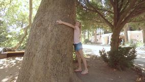 Nature-loving white girl hugging an old sycamore. The Estate Of Pushkin. Gurzuf. Crimea. stock video