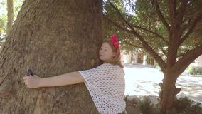 Nature-loving white girl hugging an old sycamore. The Estate Of Pushkin. Gurzuf. Crimea. stock footage