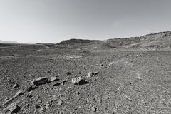 Nature of the Middle East. Rocky hills of the Negev Desert in Israel. Breathtaking landscape and nature of the Middle East. Black and white photo royalty free stock images