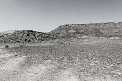 Nature of the Middle East. Rocky hills of the Negev Desert in Israel. Breathtaking landscape and nature of the Middle East. Black and white photo royalty free stock image