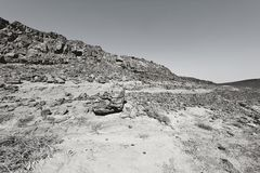 Nature of the Middle East. Rocky hills of the Negev Desert in Israel. Breathtaking landscape and nature of the Middle East. Black and white photo stock image