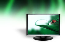 Nature of the monitor. Monitor representing a drop of dew on an abstract background Royalty Free Stock Images