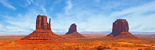 Nature in Monument Valley Navajo Park, Utah USA. Red desert landscape, famous view on a beautiful summer day with blue sky and clouds Royalty Free Stock Photos