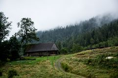 The nature of the mountain is the old hut and the fog Royalty Free Stock Photo