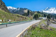 Nature of mountains, green trees and blue sky, road on Medeo in Almaty, Kazakhstan,Asia royalty free stock image