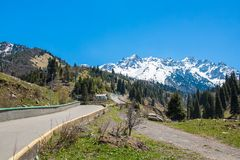 Nature of  mountains,  green trees and blue sky, road on Medeo in Almaty, Kazakhstan at summer Stock Photos