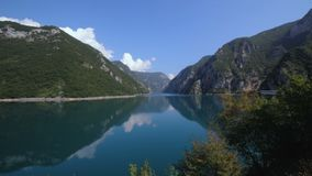 Beautiful nature mountains of Montenegro with lake or river with clean water stock video