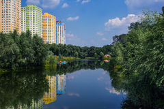 Nature. Near the town of Lake built tall buildings Stock Image