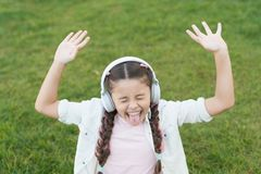 Nature is the one song of praise that never stops singing. Happy song singer on green grass. Little girl singing song stock photos
