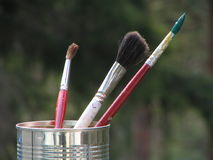 Nature painter. Watercolor brushes in tin can Royalty Free Stock Photo