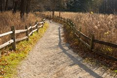 Nature path with splitrail fence at the Little Red Schoolhouse Nature Center. In Willow Springs, Illinois Stock Image