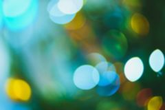 Nature light background- bokeh christmas. Illuminated decor. Nature pattern- light bokeh background. Celebratory mood magic effect. Decorations holiday- design Royalty Free Stock Image