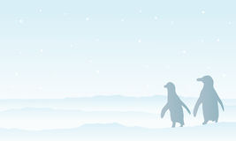 Nature penguin on snow silhouette scenery Stock Photo