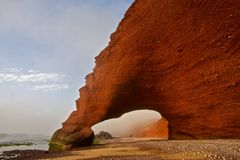 Nature phenomenon. Stone arches at Morocco. Amazing creation of waves and wind. Atlantic ocean. Legzira Stock Photos