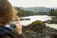 Nature by phone. Girl takes picture of nature Royalty Free Stock Images