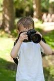 Nature Photographer. Five year old enjoying taking photographs Royalty Free Stock Photography