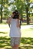 Nature Photographer. Five year old enjoying taking photographs Royalty Free Stock Photo