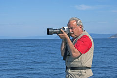 Nature photographer with camera. Nature photographer with digital camera Stock Images
