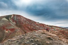 Nature photographer in red mountains. Nature photographer with camera in red mountains Royalty Free Stock Photos