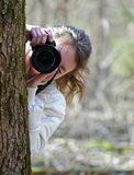 Nature photographer girl shooting you Stock Photos