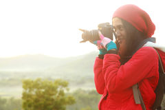 Nature photographer during hiking trip Stock Image