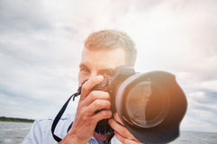 Nature photographer. An image of nature photographer takes pictures Royalty Free Stock Photography