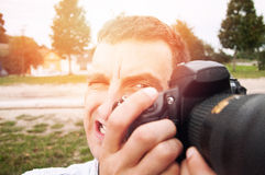 Nature photographer. An image of nature photographer takes pictures Royalty Free Stock Image