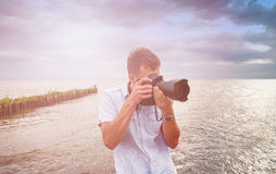 Nature photographer. An image of nature photographer takes pictures Royalty Free Stock Images