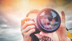 Nature photographer. An image of nature photographer takes pictures Stock Photos