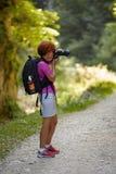 Nature photographer lady taking photos Royalty Free Stock Photo